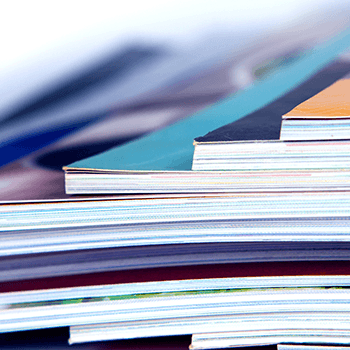 Photograph of documents arranged in a stack.