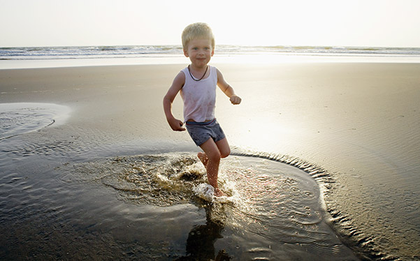 Photograph of a child playing on the beach