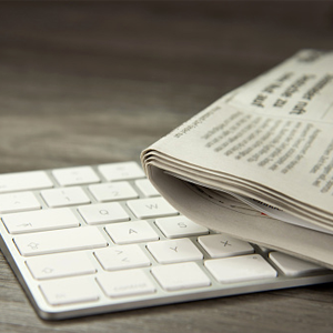 Picture of a keyboard and newspaper.