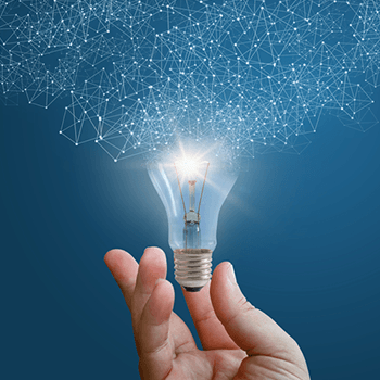 Composite image of a person holding a lightbulb to symbolize new ideas.